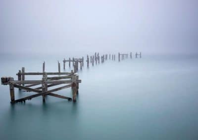 Rainy Day Pier by Roseanne Baume